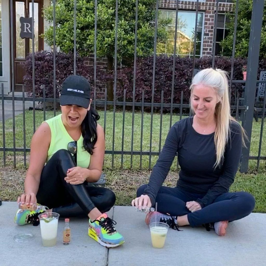 2 women making cocktails on the sidwalk