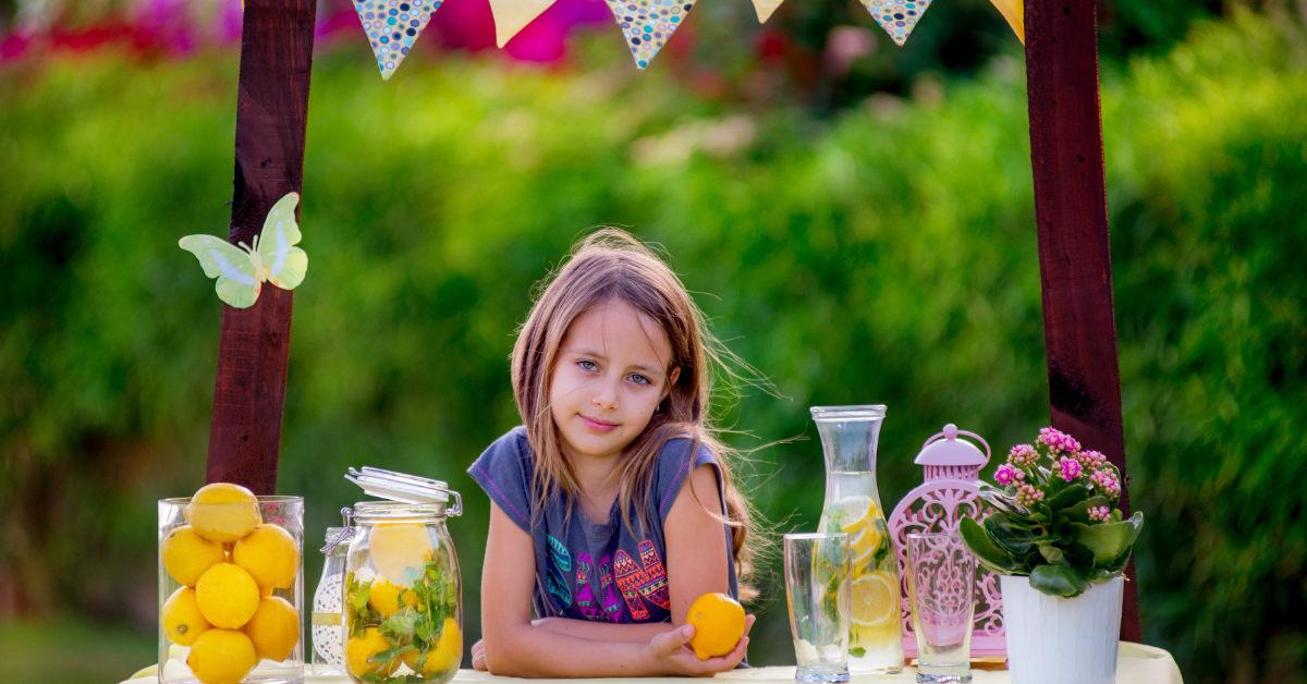 girl at lemonade stand