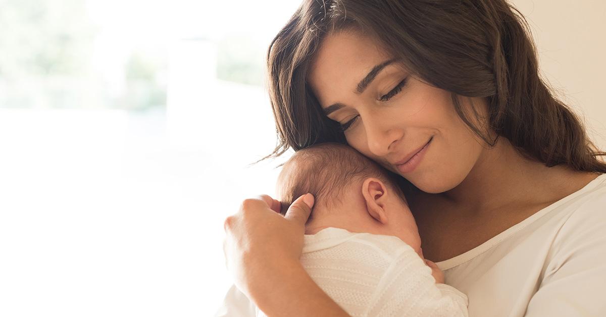 woman cuddling a baby