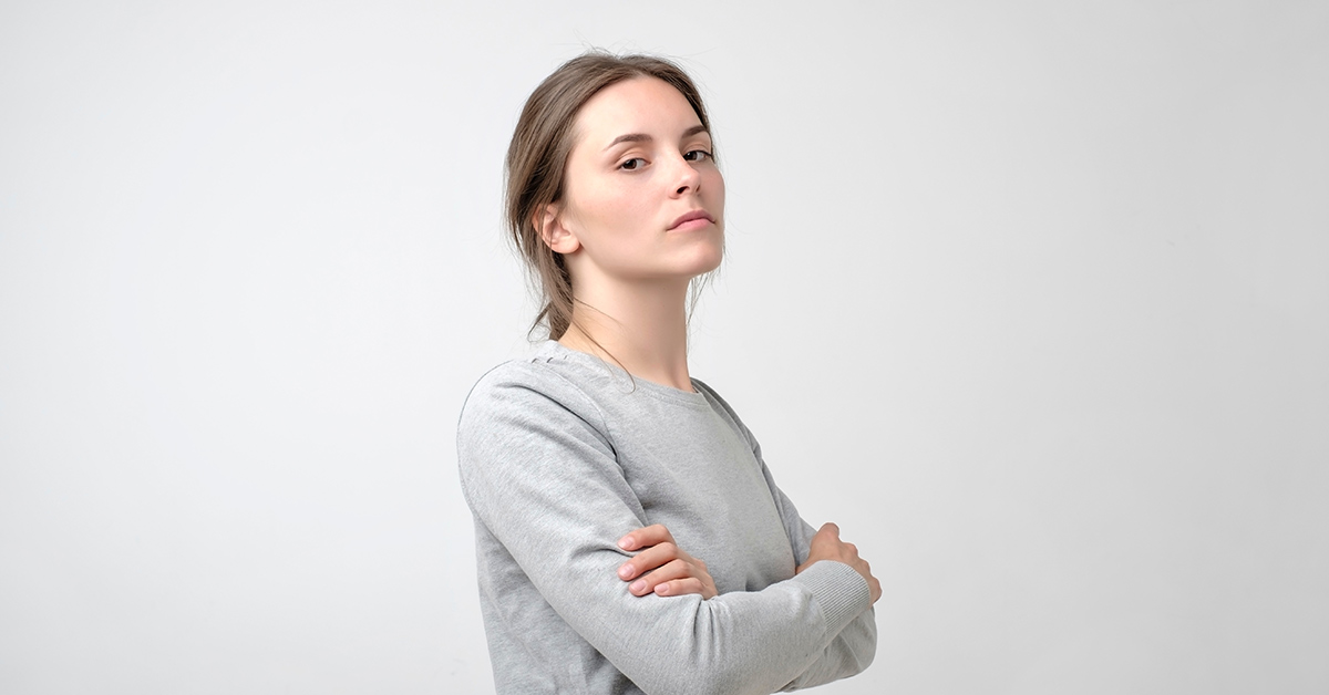 upset woman in a gray shirt