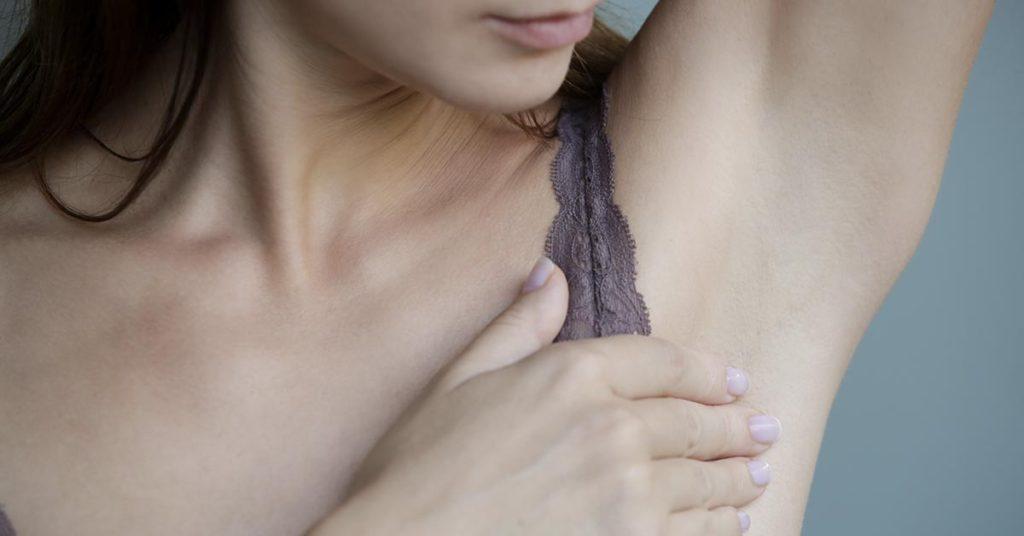 woman examining under arm