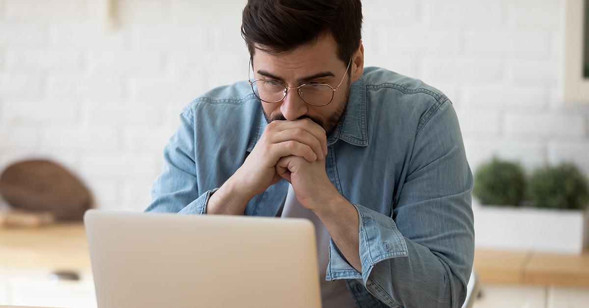 man staring at a computer