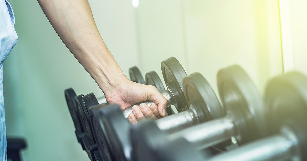 person grabbing weights