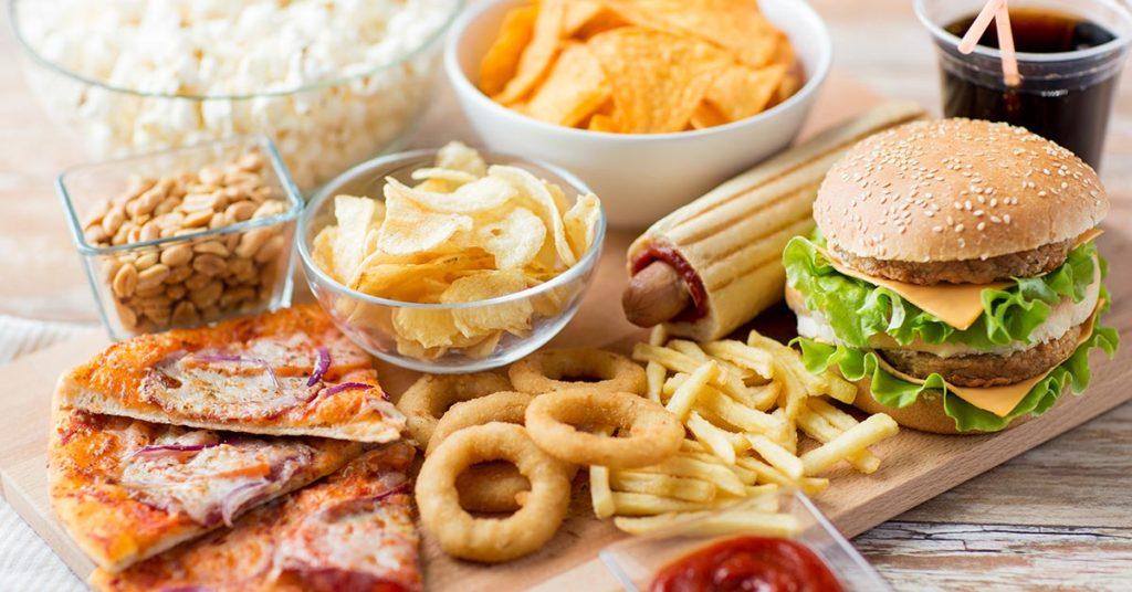 Pizza, burger, hot dog, onion rings, fries, chips peanuts, popcorn