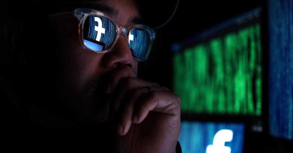 hacker viewing facebook