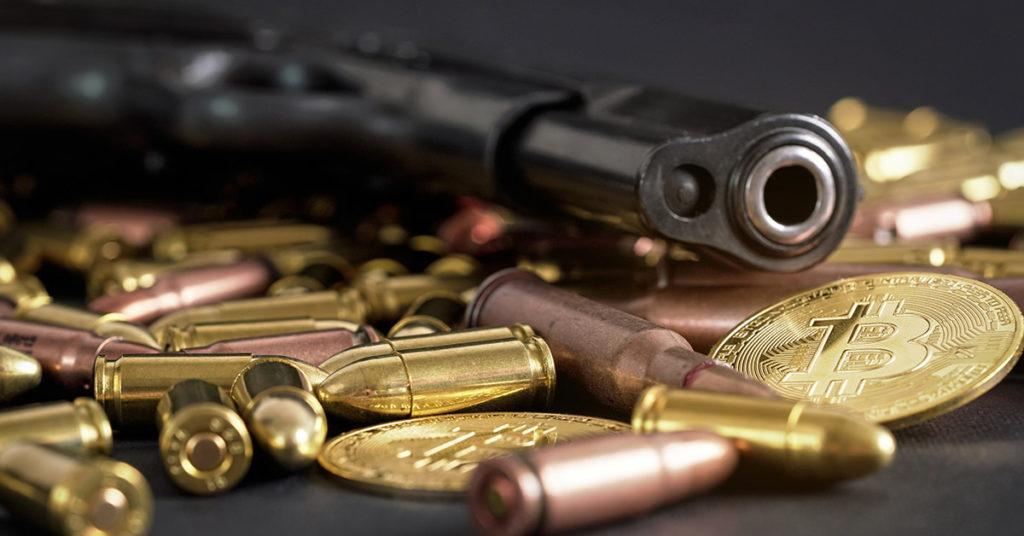 hand gun with ammunition and bitcoins