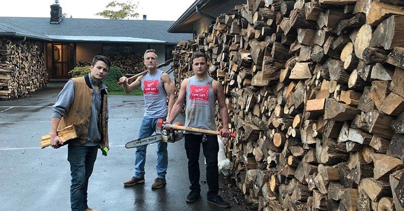 3 men chopping firewood
