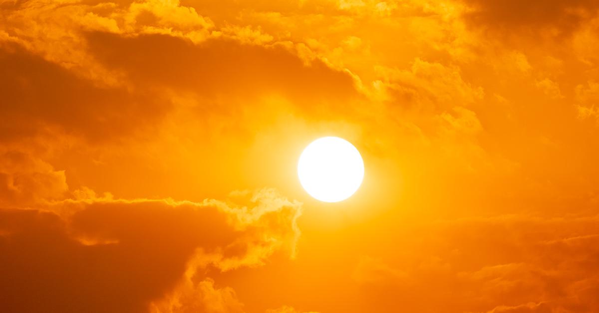 sun shining giving the sky an orange hue