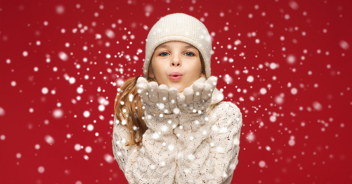 christmas themed photo with woman blowing snowy dust